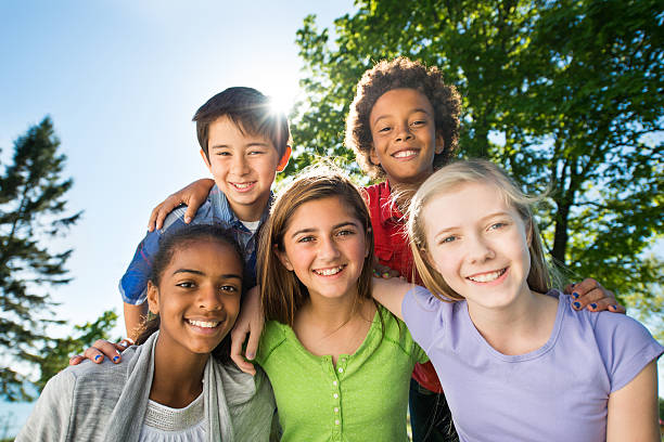 Tweens Diverse group of tweens outside in the park. 12 13 years stock pictures, royalty-free photos & images