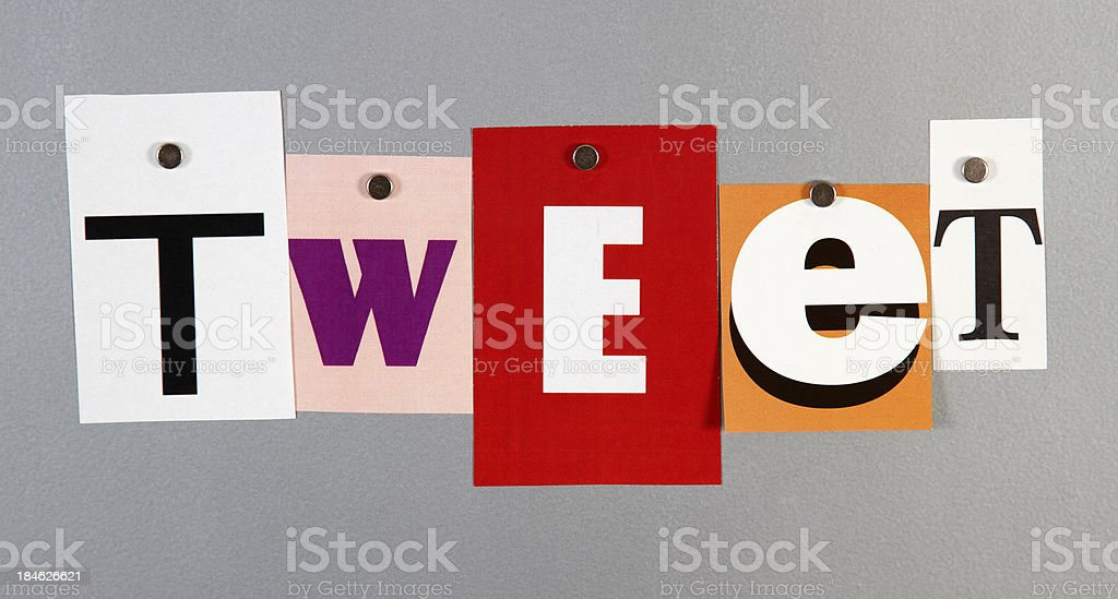 Tweet pinned on a silver metal pin board royalty-free stock photo