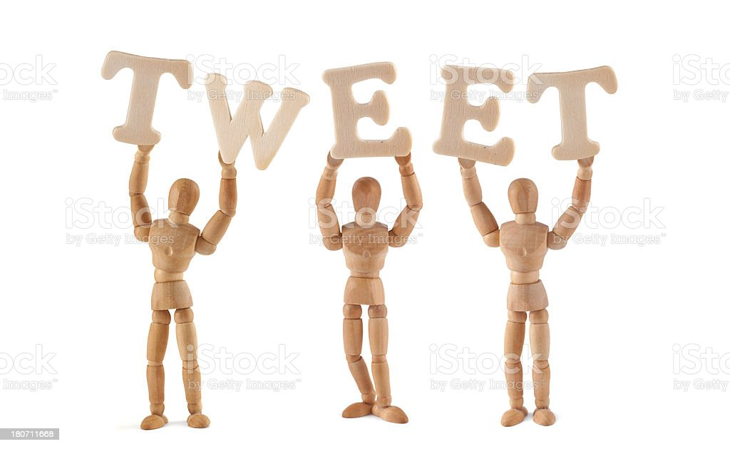 Tweet - wooden mannequin holding this word stock photo