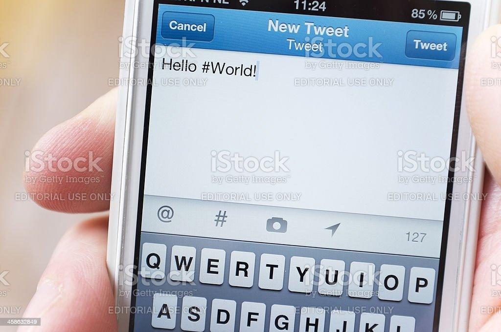 Tweeting Hello #World royalty-free stock photo