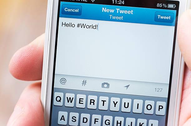 Tweeting Hello #World stock photo