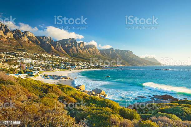Beach and Twelve Apostles mountain in Camps Bay near Cape Town in South Africa.