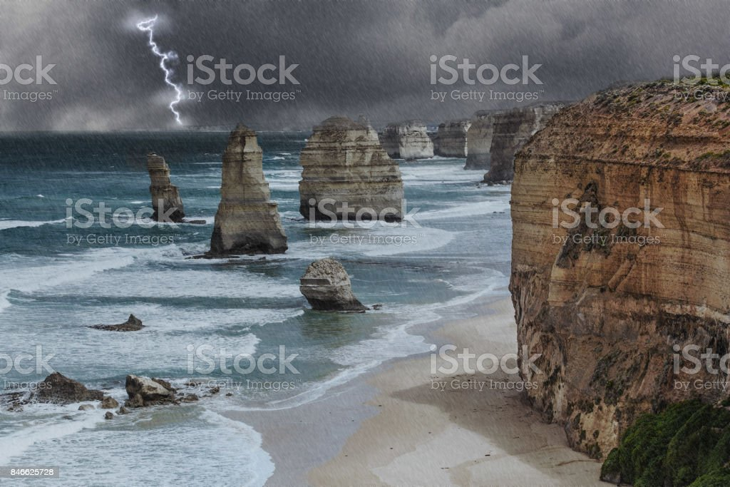 Twelve Apostles rock formations with lighting and thunderstorm, Great Ocean Road, Victoria, Australia stock photo
