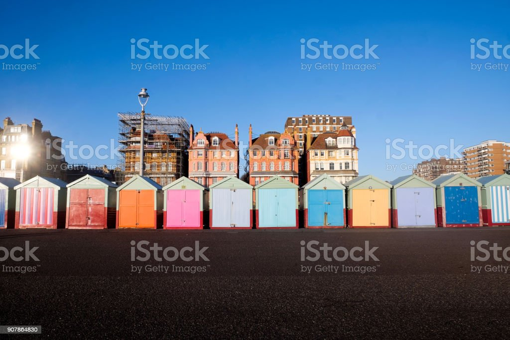 twelve beach huts in a row on Brighton beach stock photo