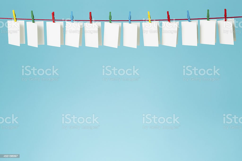Twelve blank white greeting cards on a blue background stock photo twelve blank white greeting cards on a blue background royalty free stock photo m4hsunfo