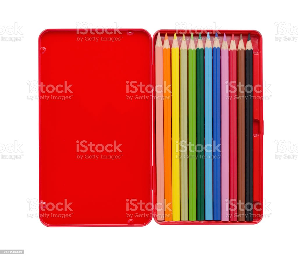 twelve colored pencils in a red case with copy space isolated on white stock photo