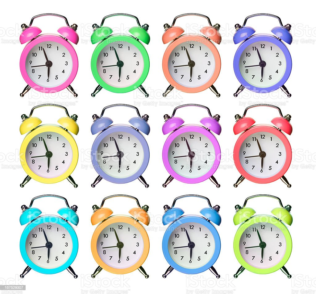 Twelve Colorful Alarm Clocks stock photo