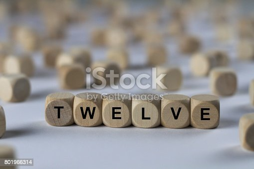 istock twelve - cube with letters, sign with wooden cubes 801966314
