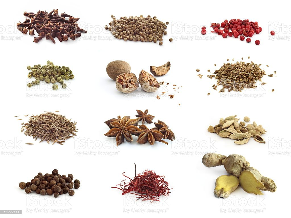 Twelve different displays of spices stock photo