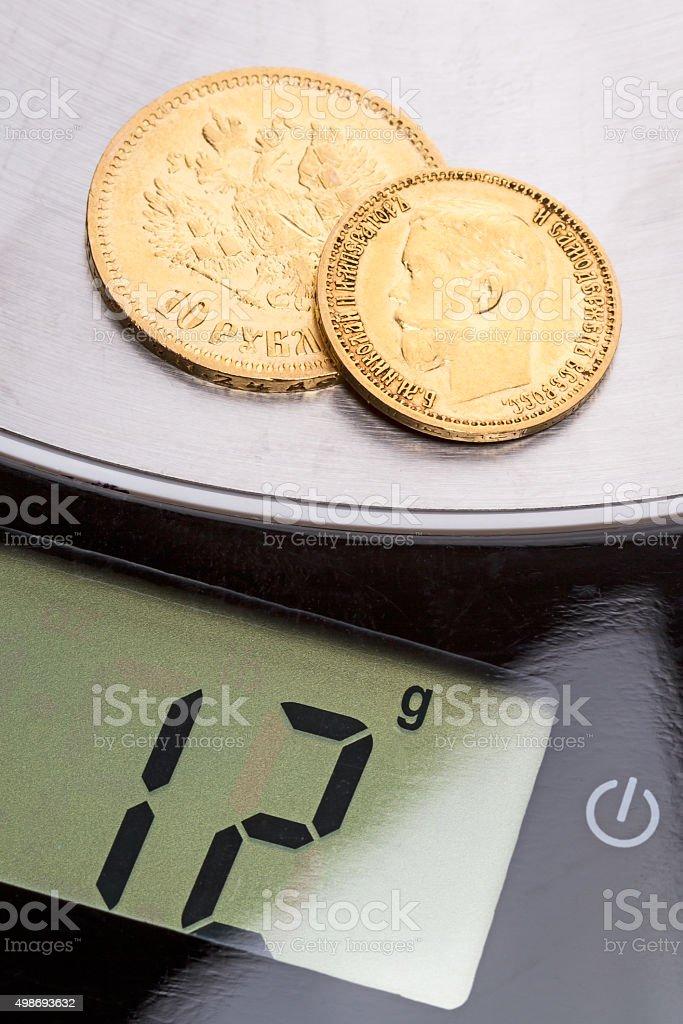 Twelve grams of pure gold stock photo