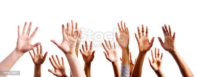 istock Twelve mixed hands raised in praise or joy against white 155073627