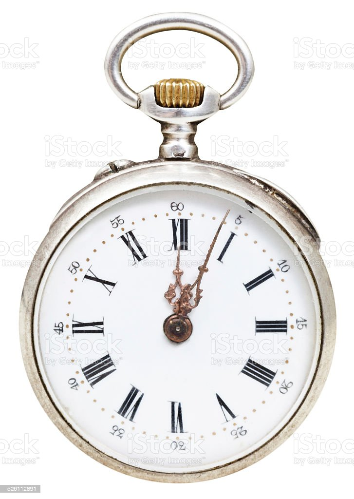 twelve o'clock and five min on dial of retro watch stock photo