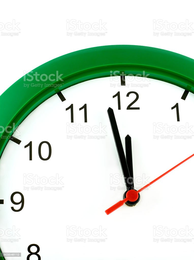 Twelve o'clock on big wall watch isolated stock photo