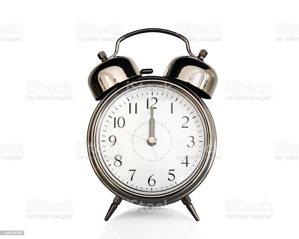 Twelve on an old vintage alarm clock isolated on white stock photo