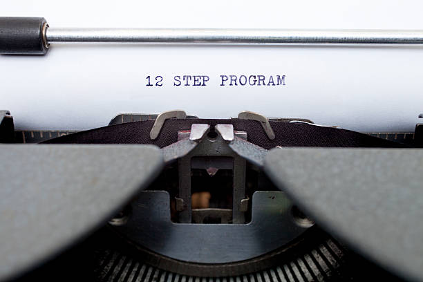 12 Twelve Step Program Typed on an Old Typewriter The words 12 Step Program typed on an old typewriter. single step stock pictures, royalty-free photos & images