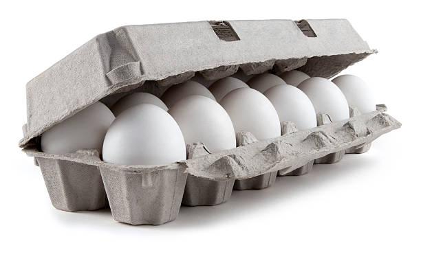 twelve white eggs in a carton package - kartonnen verpakking stockfoto's en -beelden