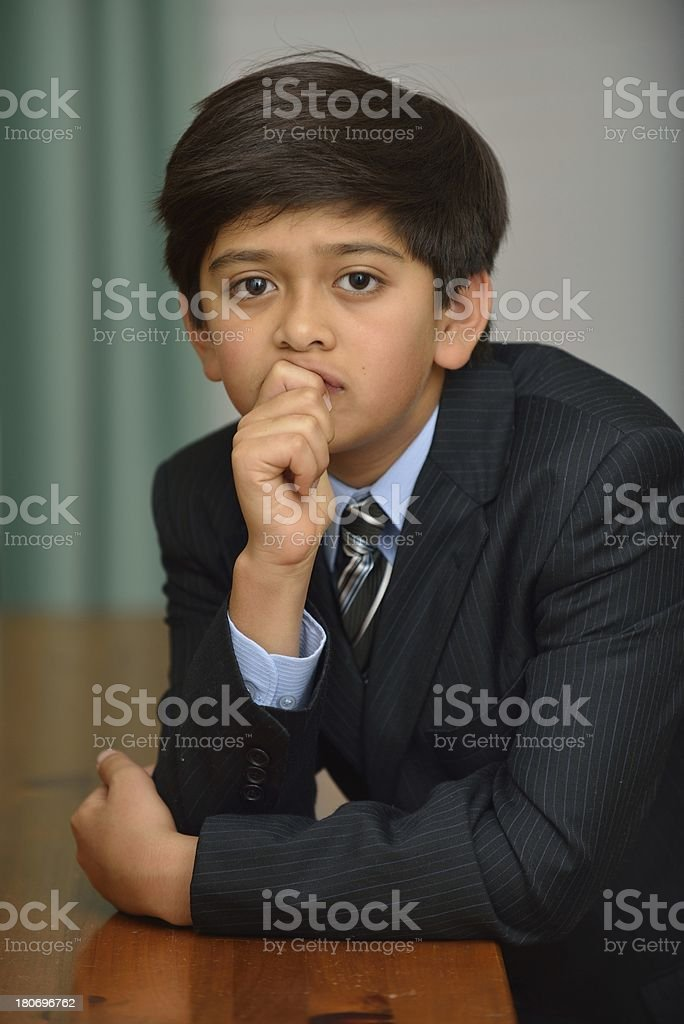 Twelve year old boy with jacket and tie royalty-free stock photo