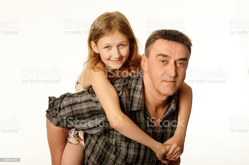 Twelve year old daughter hugging her father stock photo