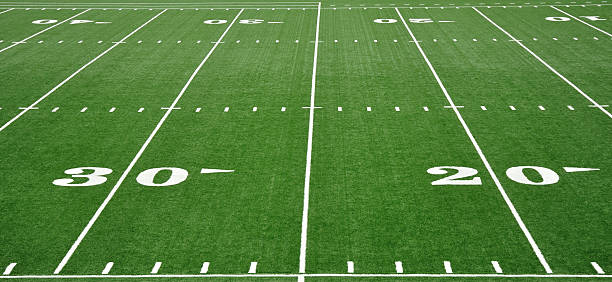 Twenty and Thirty Yard Line on American Football Field 20 and 30 Yard Line on American Football Field turf stock pictures, royalty-free photos & images