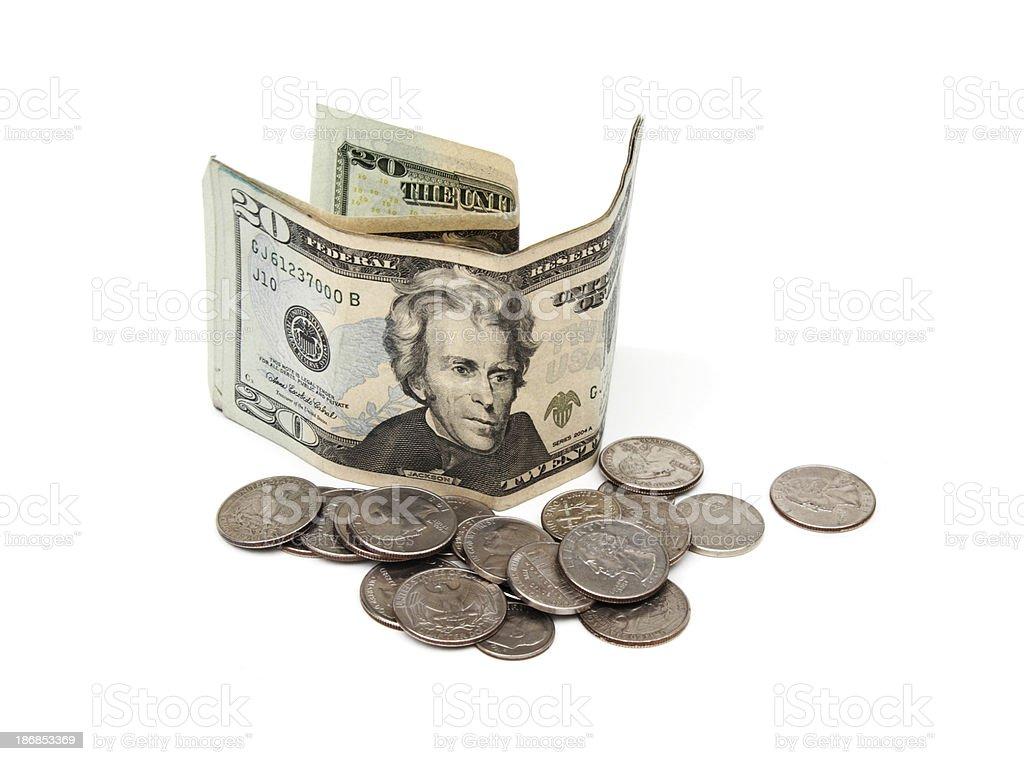Twenty dollar bill with coins royalty-free stock photo