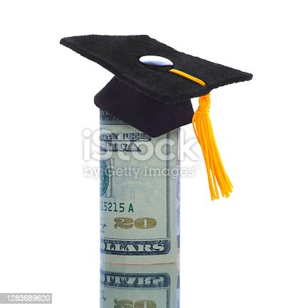istock Twenty dollar bills wrapped around themself with a mortarboard ontop representing the high cost of Education 1283689620