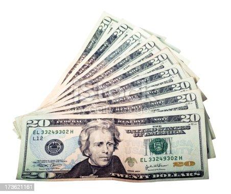 Nine twenty dollar bills isolated on white.