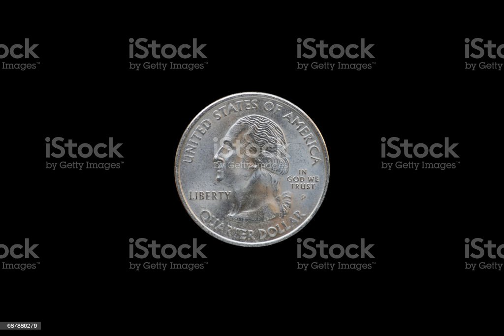 Twenty five American cents (Quarter Dollar) isolated on black background. stock photo