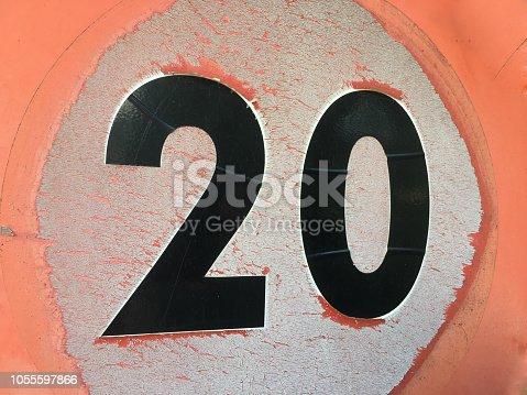 Old weathered twenty kilometers per hour sign in Spain