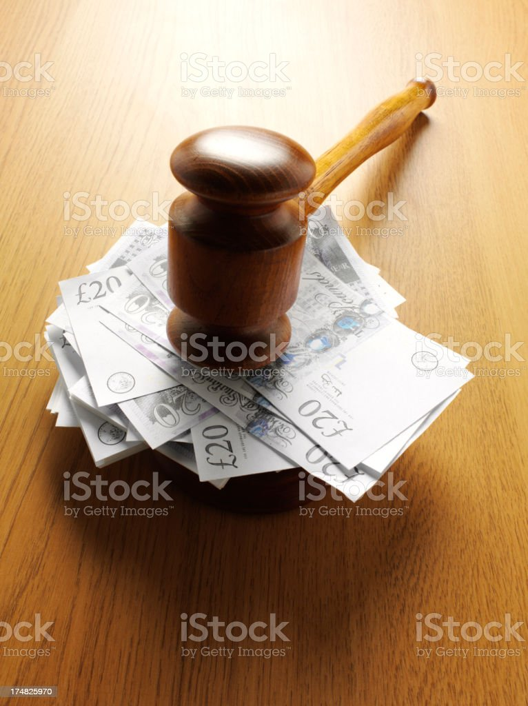 Twenty Pound Notes under a Gavel royalty-free stock photo