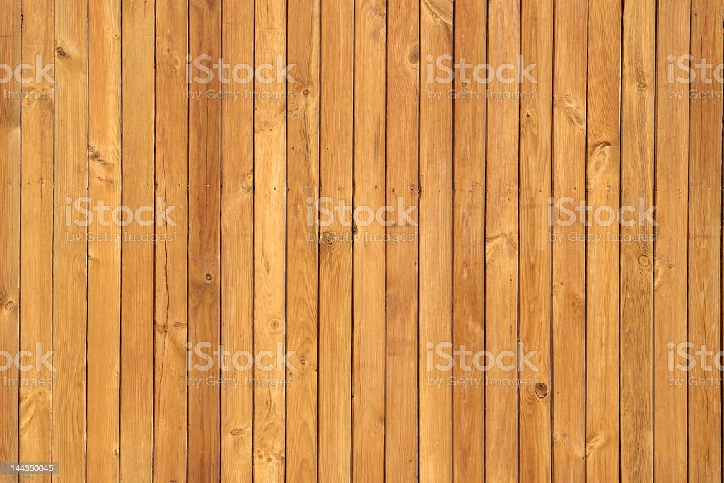 Twenty two Honey brown pine wood boards vertically lined up  royalty-free stock photo