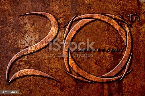 istock Twenty years anniversary on metal rust background 471604430