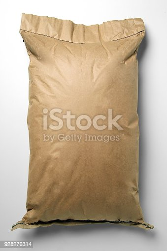 912671588istockphoto Twenty-five-pound paper bag without a brand 928276314