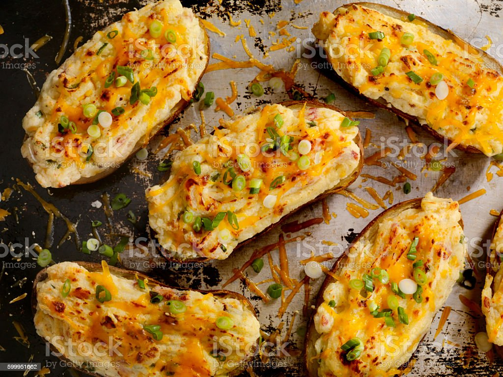 Twice Baked, Stuffed Potatoes with Cheese and Bacon stock photo