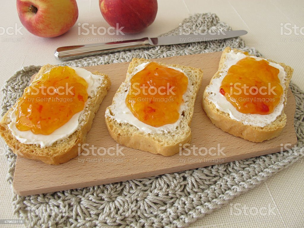 Twice-baked bread with cream cheese and peach jam stock photo