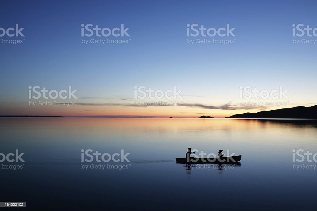 XL twilight canoeing stock photo