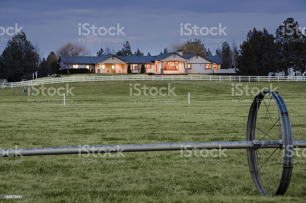 Twilight exterior of home and landscape stock photo