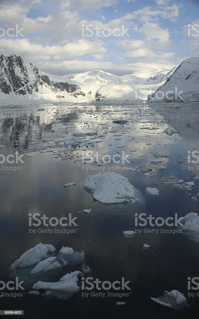 Twilight: Icy mountains reflected royalty-free stock photo