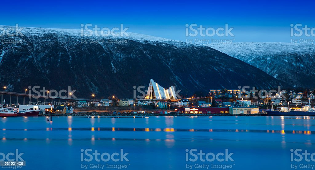 Twilight in Tromso, with Arctic Cathedral, Norway. stock photo