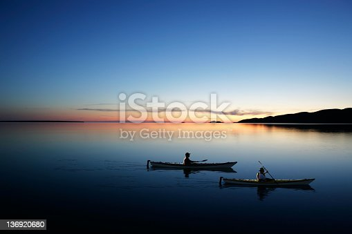 father and son kayaking on serene lake at twilight (XXL)