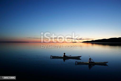 184332102istockphoto XXL twilight kayakers 136920680
