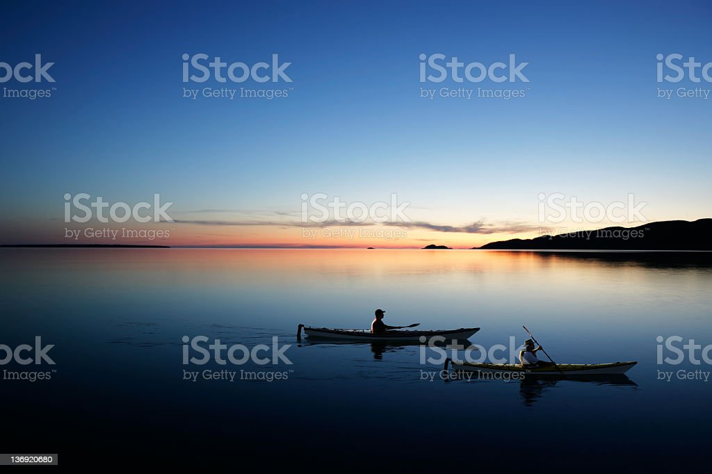 XXL twilight kayakers stock photo