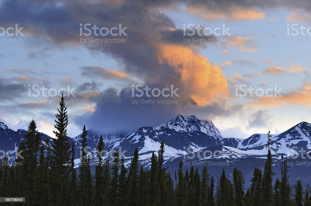 Twilight landscape with snowcapped peaks in Canadian Rockies royalty-free stock photo