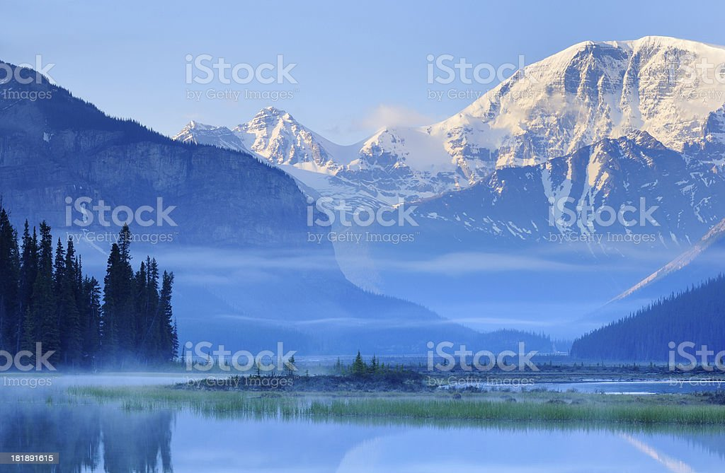 Twilight mountain landscape with reflection in Canadian Rokies stock photo