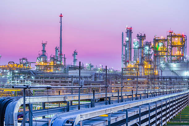 twilight of industrial petroleum plant - refinery stock photos and pictures
