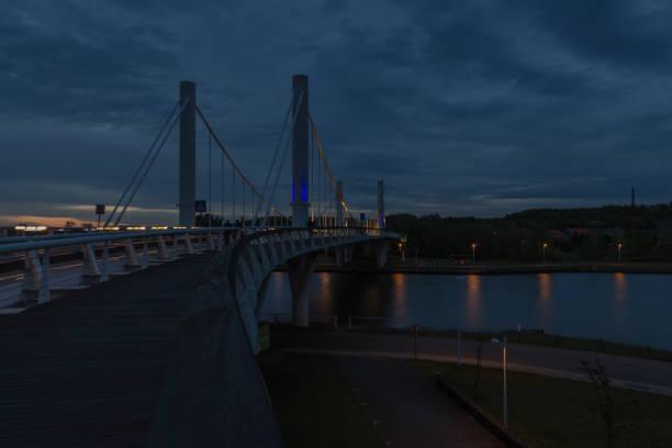 twilight op de kruising over het albert kanaal in kanne belgië - maasvallei stockfoto's en -beelden