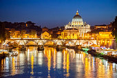 Twilight on Tiber river with sight of Vatican City, Rome, Italy