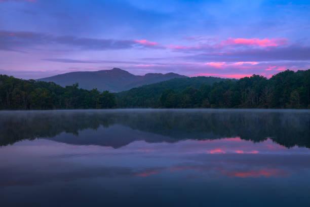Twilight over calm lake stock photo