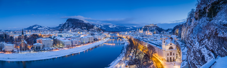Classic panoramic twilight view over the historic city of Salzburg with famous Hohensalzburg Fortress during Christmas time in winter at dusk, Salzburger Land, Austria