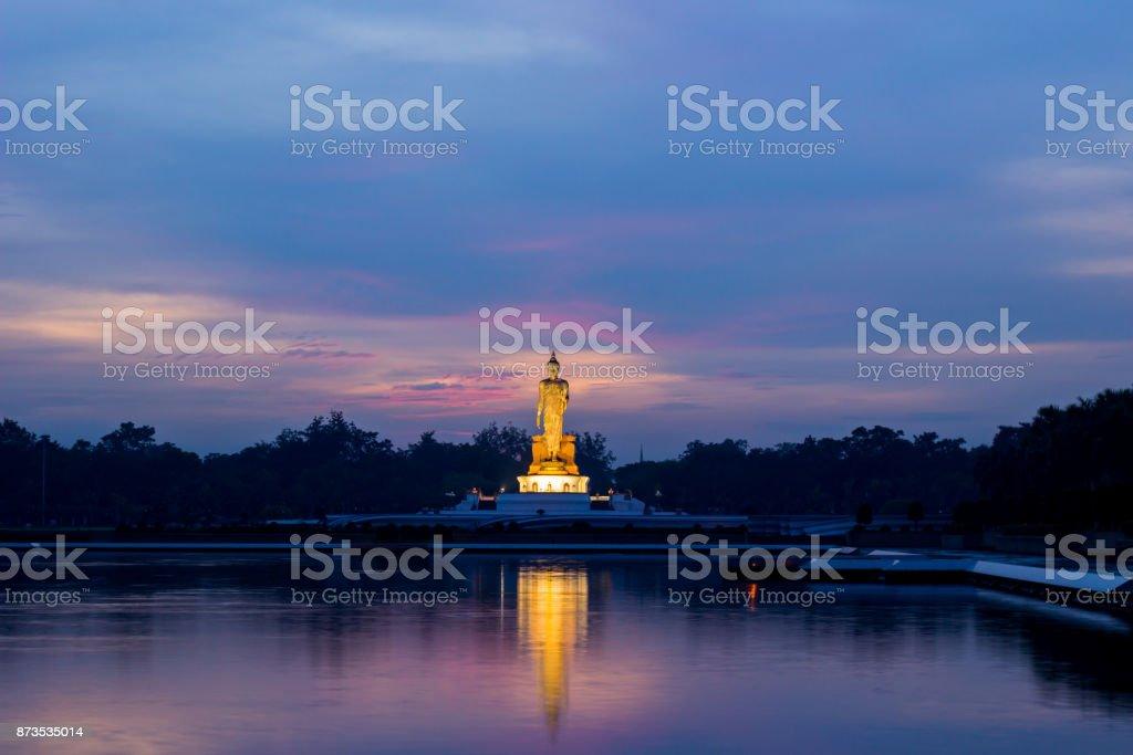 twilight sky and Buddha statue at Phutthamonthon(Buddhist park in Nakhon Pathom Province of Thailand) stock photo