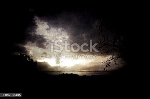 516351793 istock photo Twilight sky through Dark Storm Clouds 1134138495